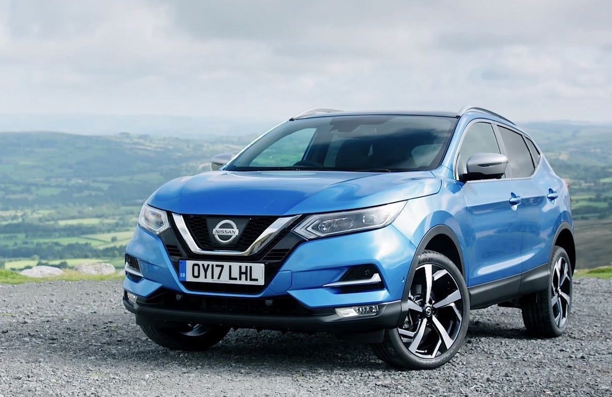 Blue Nissan Qashqai parked overlooking a countryside view.