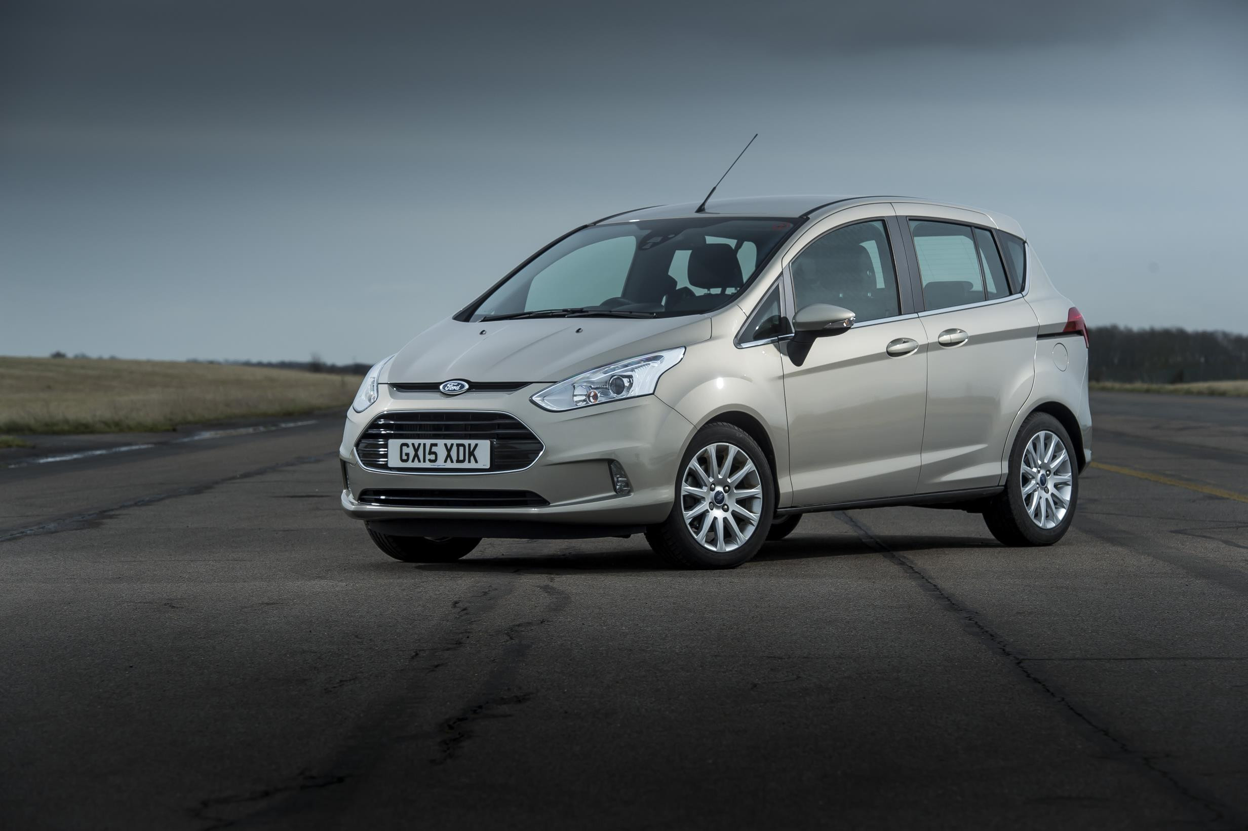 Light grey Ford B-Max parked facing three-quarters left on airport runway.