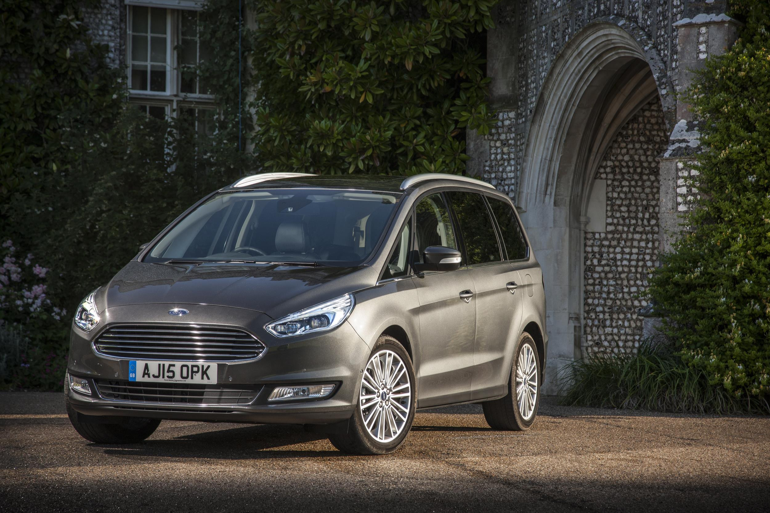 Grey Ford Galaxy parked three-quarters facing left in front of country house.