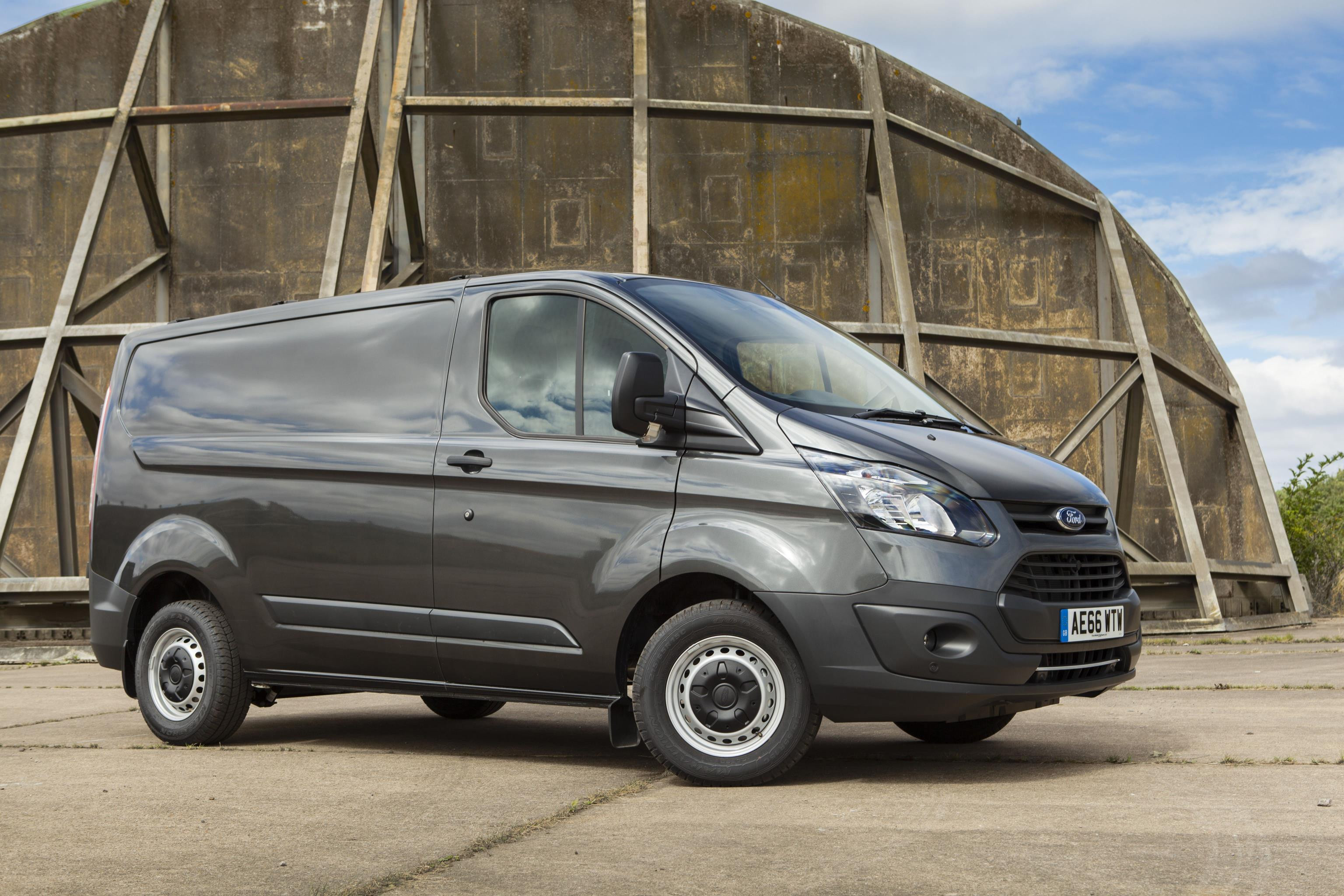 Grey Ford Transit Custom parked facing right